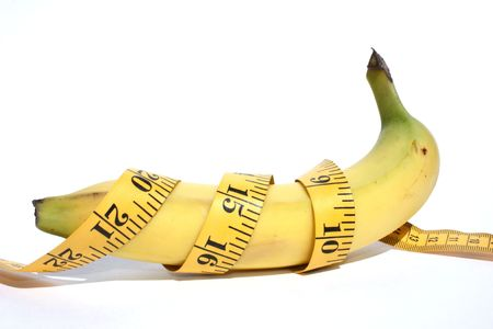 temperance: Side view of banana with tape measure around it