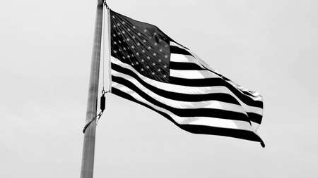 Flag of the United States of America waving, low angle view. The U.S, US, USA, American. Black and white.