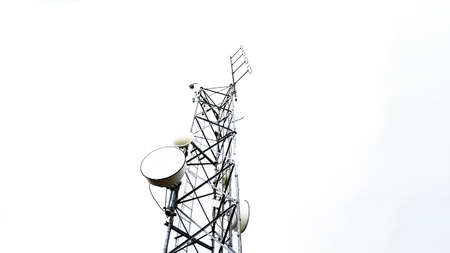 Radio antenna tower telecommunication against cloudy sky in low angle view. Isolated on white background.