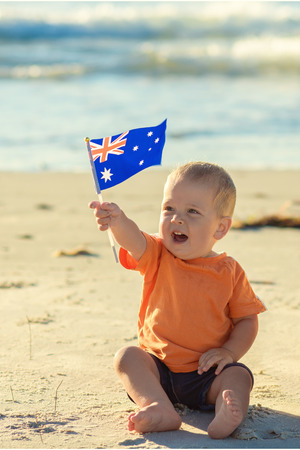 Kid is holding the flag celebrating the Australia day