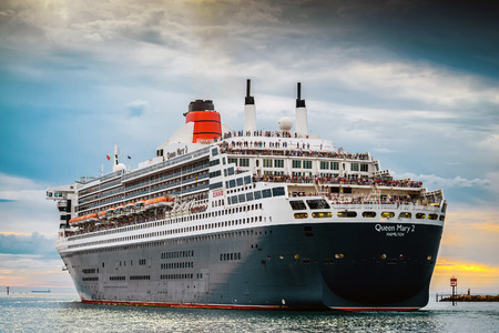 croud: Adelaide, SA, Australia - March 10, 2014: RMS Queen Mary 2 is leaving Port Adelaide, Outer Harbour, South Australia and heading to Melbourne