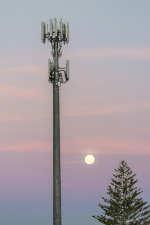 radio tower: Cellular radio tower at dusk