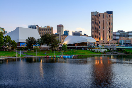 adelaide: Adelaide, South Australia - January 18, 2015: Adelaide City Business District at dusk. View from the northern bank of the Torrens river Editorial