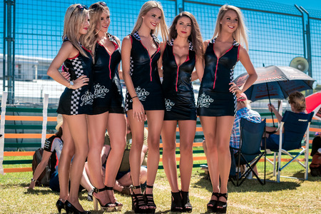 Adelaide South Australia  March 01 2014: Grid girls are interacting with visitors at Clipsal 500 V8 Supercars