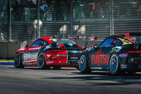 Adelaide South Australia  March 01 2014: Porsche GT3 racing cars are competing on the racing track at Clipsal 500 V8 Supercars