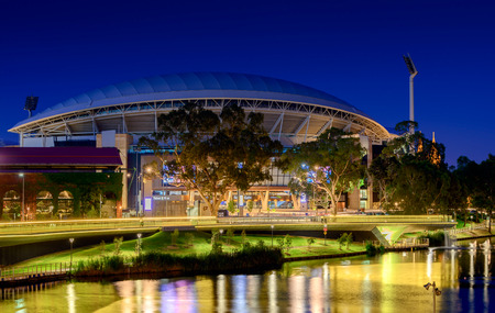 Adelaide South Australia  January 18 2015: View of Adelaide Oval and River Torrens Foot Bridge at night. This place is one of the most popular tourist attractions in the city of Adelaide. Long exposure effect Redakční