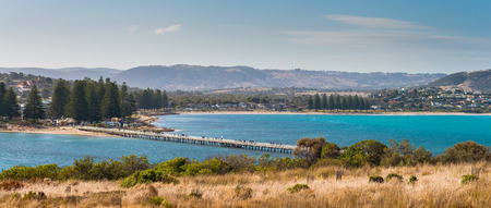 foot bridge: People walking along the foot bridge at Victor Harbor South Australia. View from the island Stock Photo
