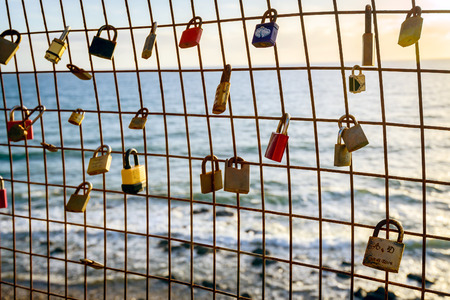 multiplicity: Rusty love locks hanging on the fence as a symbol of loyalty and eternal love
