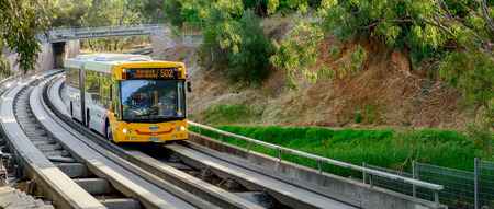 Adelaide, Australia - December 15, 2013: Adelaide Metro bus is travelling from the city towards the Salisbury Interchange. The Adelaide O-Bahn is a guided busway that is servicing the northeastern suburbs of Adelaide