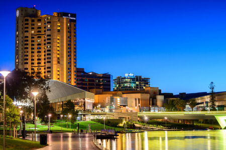 adelaide: Adelaide, South Australia - January 18, 2015: Intercontinental Hotel and Riverbank Bridge across Torrens River at night Editorial