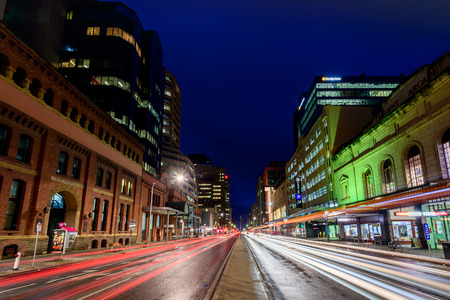 light traces: Adelaide, South Australia - August 11, 2015: Grenfell street traffic at night and light traces of passing cars. Photo taken in long exposure mode.