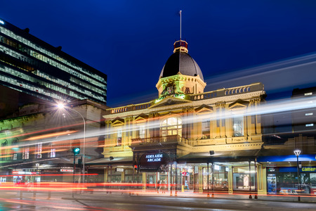 adelaide: Adelaide, South Australia - August 11, 2015: Adelaide Arcade building at night with traffic along the Grenfell Street. Long exposure settings applied.