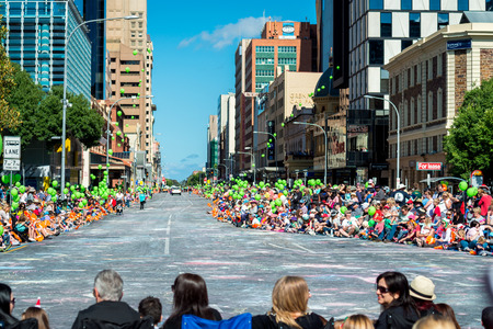 credit union: Adelaide, South Australia - November 14, 2015: Big crowds of people awating for the beginning of Credit Union Christmas Pageant 2015. Christmas Pageant is a community event with fantasy and fairy floats, colourful characters, clowns, bands, dancers and mo