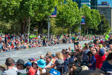 pageant: Adelaide, South Australia - November 14, 2015: Big crowds of people awating for the beginning of Credit Union Christmas Pageant 2015. Christmas Pageant is a community event with fantasy and fairy floats, colourful characters, clowns, bands, dancers and mo