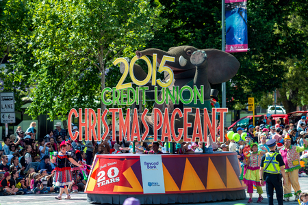 credit union: Adelaide, South Australia - November 14, 2015: Main Christmas Pageant float making turn from Pulteney to Grenfell street. Christmas Pageant is a community event with fantasy and fairy floats, colourful characters, clowns, bands, dancers and more!