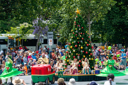 Adelaide, South Australia - November 14, 2015: Christmas Tree float with kids at the Credit Union Christmas Pageant 2015. Christmas Pageant is a community event with fantasy and fairy floats, colourful characters, clowns, bands, dancers and more!