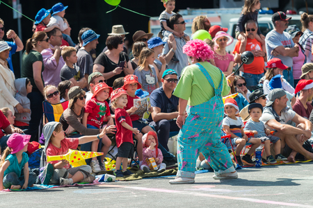 christmas fairy: Adelaide, South Australia - November 14, 2015: Clown interacting with kids at Christmas Pageant. Christmas Pageant is a community event with fantasy and fairy floats, colourful characters, clowns, bands, dancers and more!