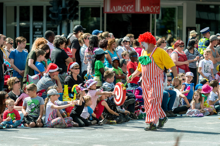 Adelaide, South Australia - November 14, 2015: Clown interacting with kids at Christmas Pageant. Christmas Pageant is a community event with fantasy and fairy floats, colourful characters, clowns, bands, dancers and more!