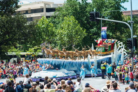credit union: Adelaide, South Australia - November 14, 2015: Father Christmas arriving at Credit Union Christmas Pageant 2015. Christmas Pageant is a community event with fantasy and fairy floats, colourful characters, clowns, bands, dancers and more!