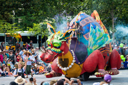 Adelaide, South Australia - November 14, 2015: Kids riding Flights of Fancy with Granny Flo character during Credit Union Christmas Pageant event. Christmas Pageant is a community event with fantasy and fairy floats, colourful characters, clowns, bands, d