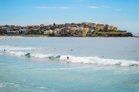 ünlü yer: Sydney, Australia - November 6, 2015: Surfers at the Bondi Beach on a day. Bondi beach is one of the most famous places for surfing in Australia