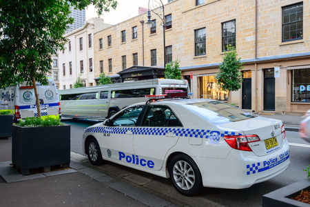 police force: Sydney, Australia - November 7, 2015: Police cars parked in the Sydney CBD area. NSW Police Force was formally established in 1862.