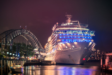 destination: Sydney, Australia - November 7, 2015: Costa Luminosa cruise ship docked at Sydney International Passenger Terminal ready to depart for the next cruise. The ship has a lot of innovative features, such as a 4D cinema, Playstation World, two swimming pools,