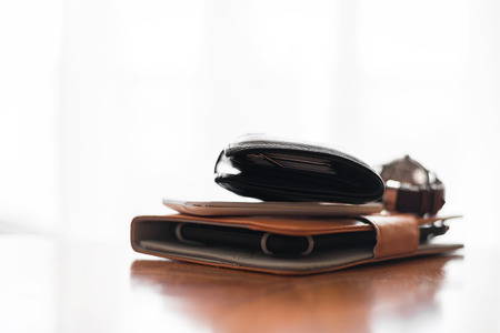 personal accessory: Tablet PC, wallet, mobile phone and watches on the table Stock Photo