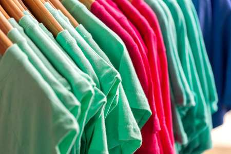hangers: Colorful t-shirts on hangers