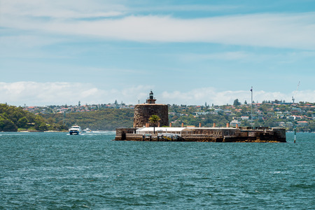 occupying: Fort Denison is a former penal site and defensive facility occupying a small island. Stock Photo