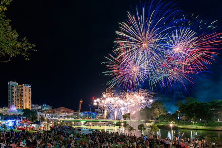 adelaide: Adelaide, Australia - January 26, 2016: People gathered in Elder Park to celebrate and watch the Australia Day fireworks. More than 40000 of people attended the event. Editorial