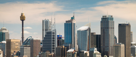 sydney: Panoramic view at Sydney city urban skyline from Western Plains with blue sky and clouds on a bright day