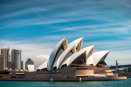 formally: Sydney, Australia - November 10, 2015: The Sydney Opera House is a multi-venue performing arts centre identified as one of the 20th centurys most distinctive buildings. It was formally opened on 20 October 1973.