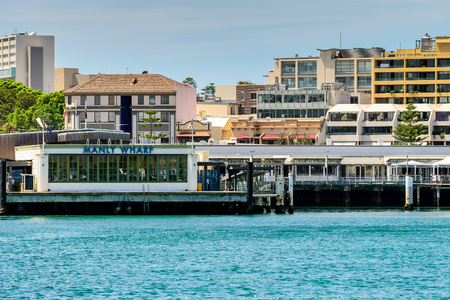 manly: Sydney, Australia - November 10, 2016: Manly Wharf Ferry Station near Sydney. Manly is very popular and spectacular beach-side suburb for tourists and locals with famous beaches around. Editorial