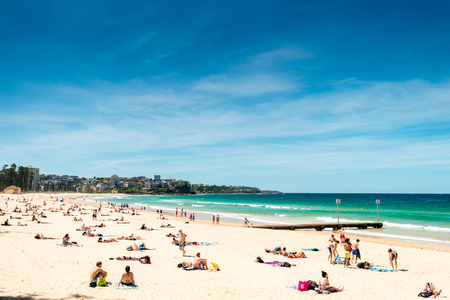 manly: Sydney, Australia - November 10, 2015: People relaxing on the Manly Beach during a warm sunny day. Editorial