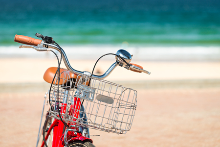 manly: Red vintage style bicycle parked at Manly Beach, Australia Stock Photo