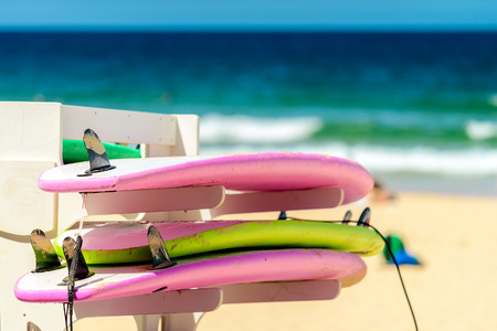 manly: Surfing boards placed on the rack in a row at  Manly Beach, Australia Stock Photo
