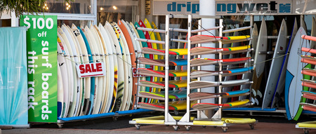 manly: Sydney, Australia - November 10, 2015: Surfing boards in a row on sale at  Manly Beach surfing boards shop