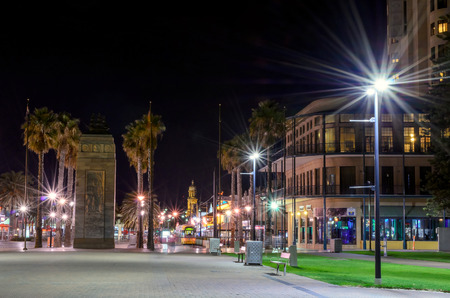 promoted: Adelaide, Australia - April 16, 2013: Moseley Square at night. Moseley Square is a public square in the City of Holdfast Bay at Glenelg. It was named after an early councillor who promoted the building of a railway line to Glenelg Editorial