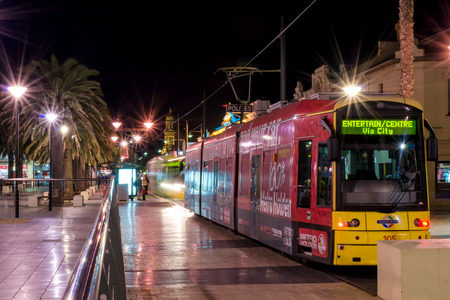 holdfast: Adelaide, Australia - April 16, 2013: Trams at Moseley Square on a night. Moseley Square is a public square in the City of Holdfast Bay at Glenelg. Long exposure camera settings.