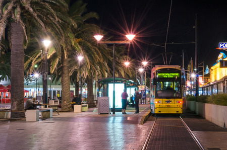 holdfast: Adelaide, Australia - April 16, 2013: Tram at Moseley Square on a night. Moseley Square is a public square in the City of Holdfast Bay at Glenelg. Long exposure camera settings Editorial