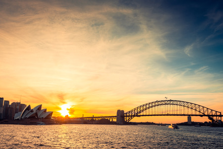 Sydney city silhouette at sunset. Cross-processing and color toning effects applied