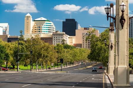 adelaide: Adelaide, Australia - January 3, 2016: King William Road bridge across the River Torrens in Adelaide city looking south during a day Editorial