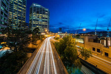 distributor: Sydney, Australia - November 10, 2015: Long exposure car light trace at Western Distributor Fwy. View from Pyrmont Bridge towards south.