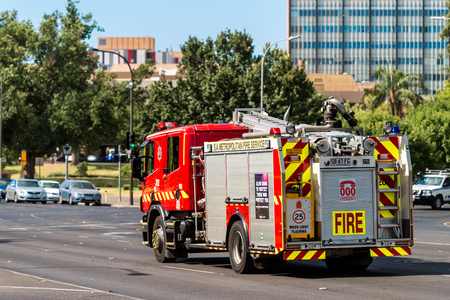 Adelaide, Australia - January 3, 2016: SA Metropolitan Fire Service Truck driving to an incident along King William road in Adelaide