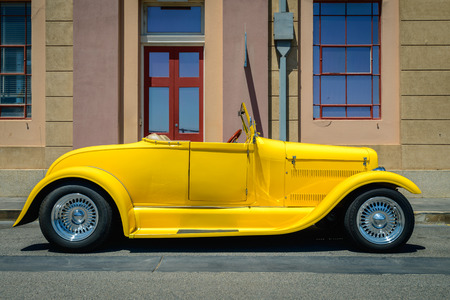 street rod: Adelaide, Australia - February 9, 2014: Yellow custom hot rod parked on the street on a bright day