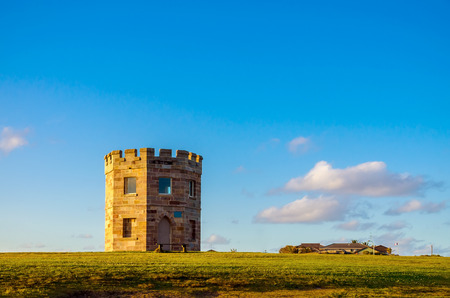 the 19th century: Sydney, Australia - September 15, 2012: 19th century Customs Tower, also known as Macquarie Watchtower at La Perouse, Botany Bay during the evening
