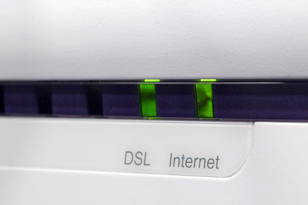 gigabit: ADSL2+ modem connected to the internet with green light DSL and internet indicators