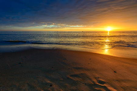 holdfast: Tropical warm sunset at the beach Stock Photo