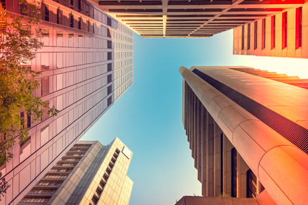 cbd: Upward view of Adelaide office buildings in CBD. Color-toning applied. Stock Photo